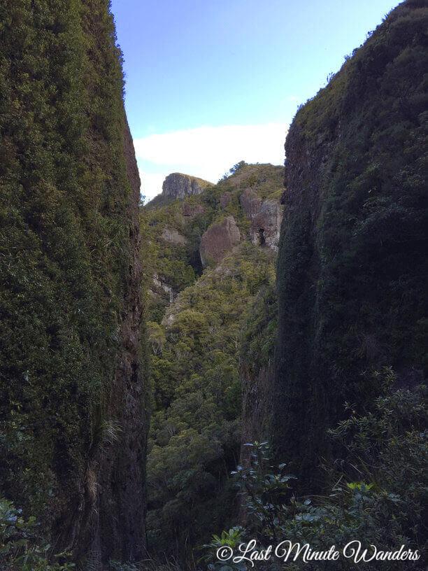 View through rock canyon to more rocks behind.