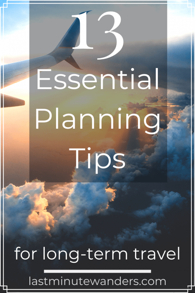 View from plane of clouds with text overlay - 13 essential planning tips for long term travel