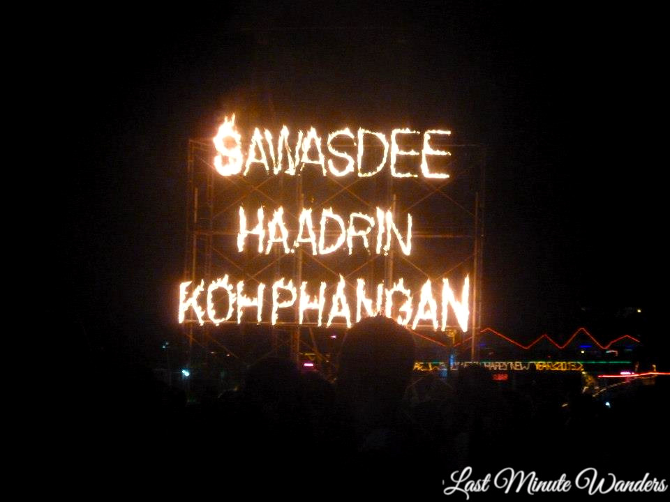 Fire sign in Thailand reading 'Sawasdee Haadrin Koh Phangan'