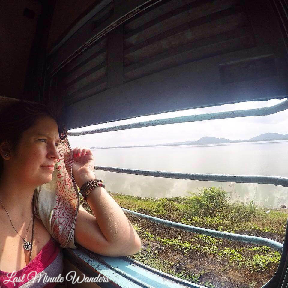 Woman sat at train window in India