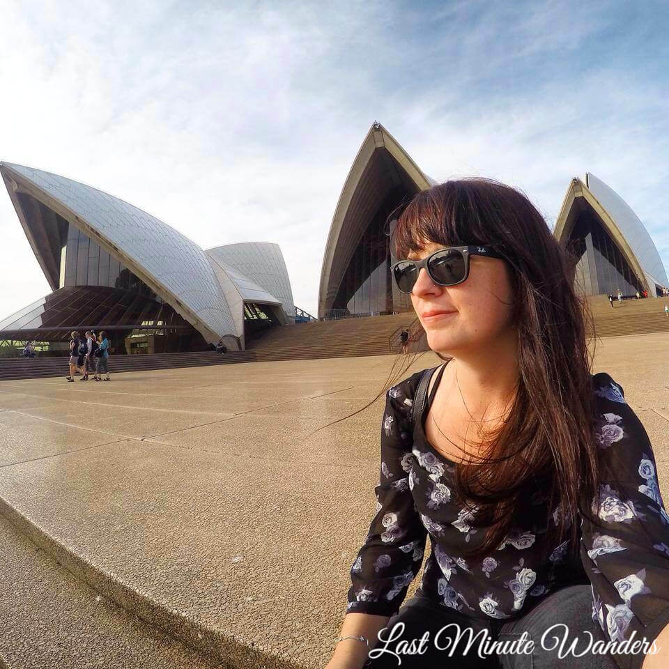 Woman sat in front of Sydney Opera House