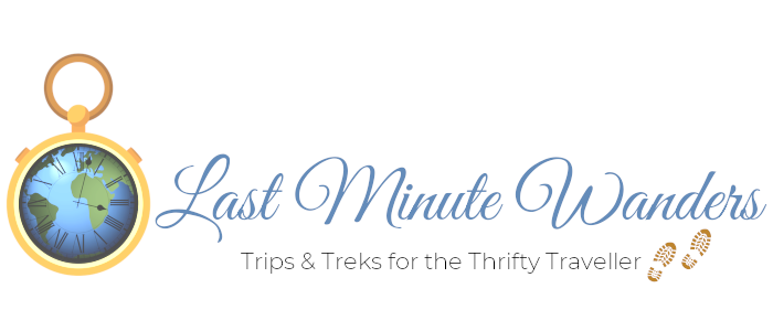 Timepiece with earth detail next to text: Last Minute Wanders - trips & treks for the thrifty traveller