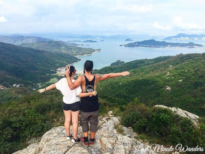 Couple on top of mountain looking over islands