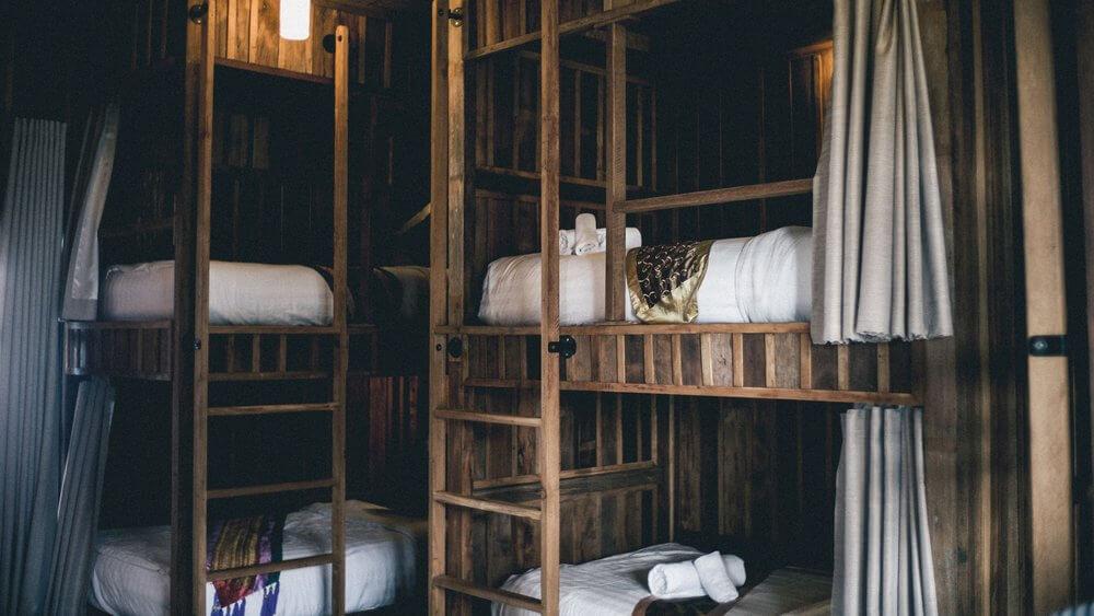 Wooden hostel dorm bunk beds