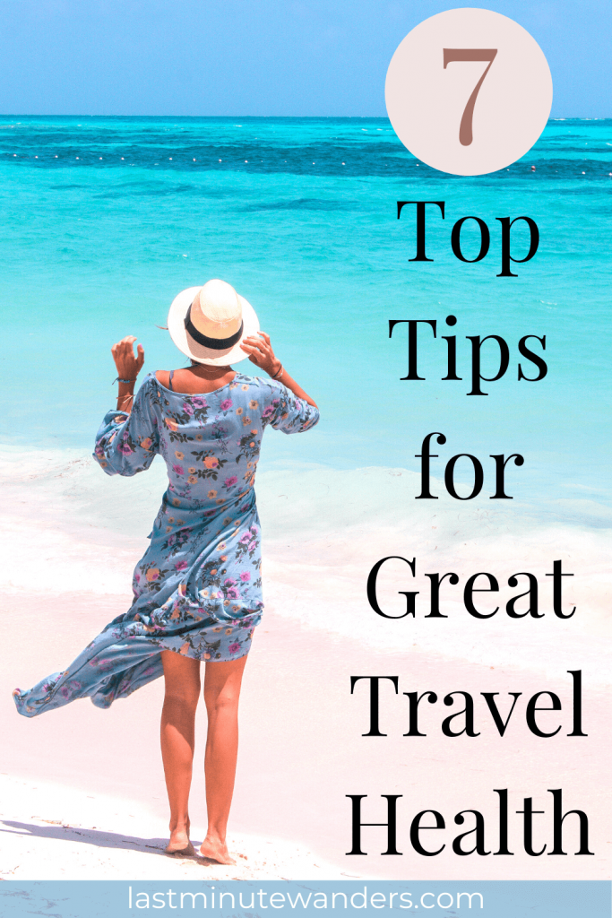 Woman in blue dress and sunset standing on beach with text overlay - 7 top tips for great travel health.