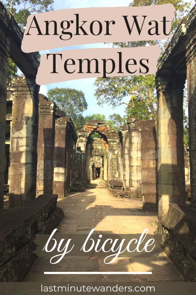 A ruined stone hallway lined with pillars and open to the sky. Text overlay reads: Angkor Wat temples by bicycle.