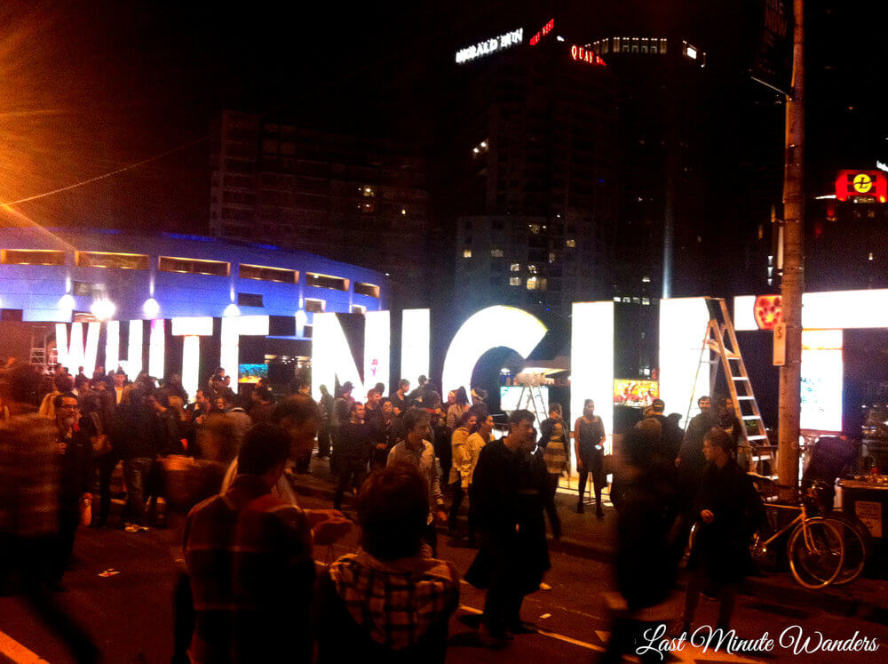 Busy bridge with lit up sign for white night