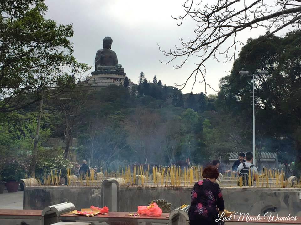 Big buddha statue over incense garden