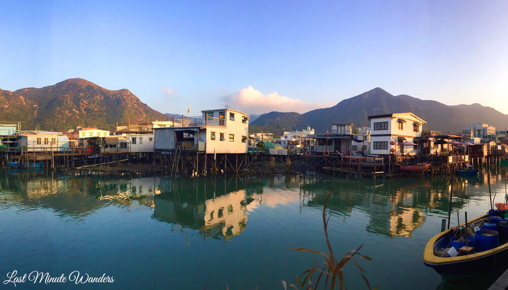 Fishing village stilt houses in front of mountains