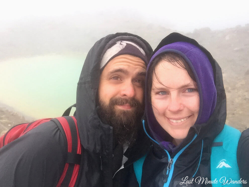 Couple wearing waterproofs in fog