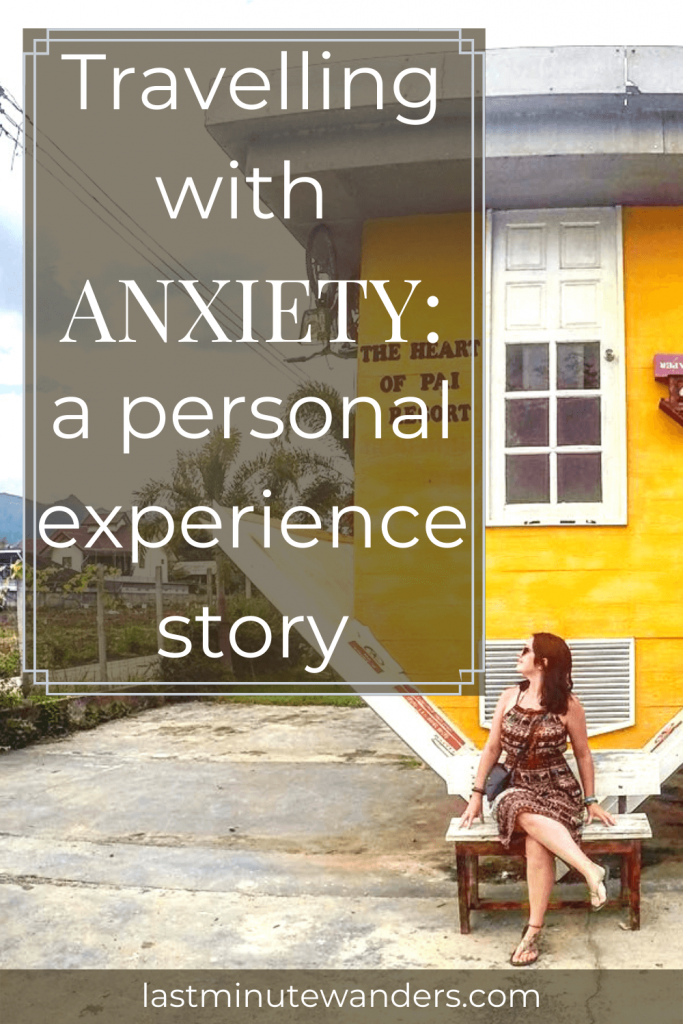 Woman sitting in front of upside down yellow house with text overlay - Travelling with anxiety: a personal experience story