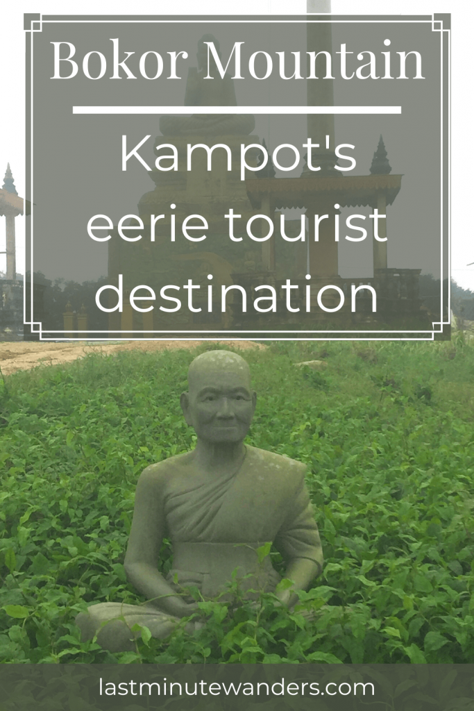 Stone statue of sitting monk in leaves with text overlay - Bokor Mountain: Kampot's eerie tourist destination