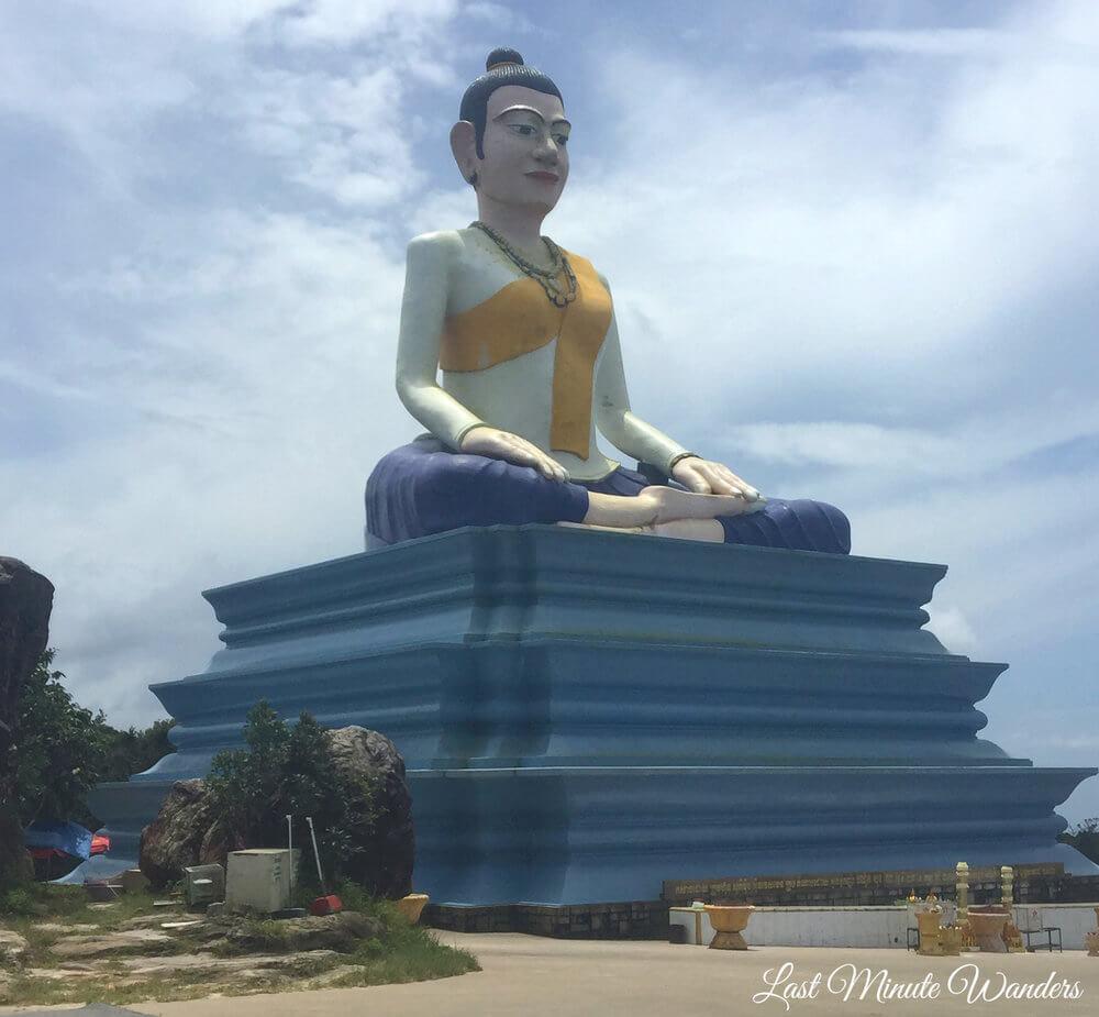 Tall statue of Buddhist deity