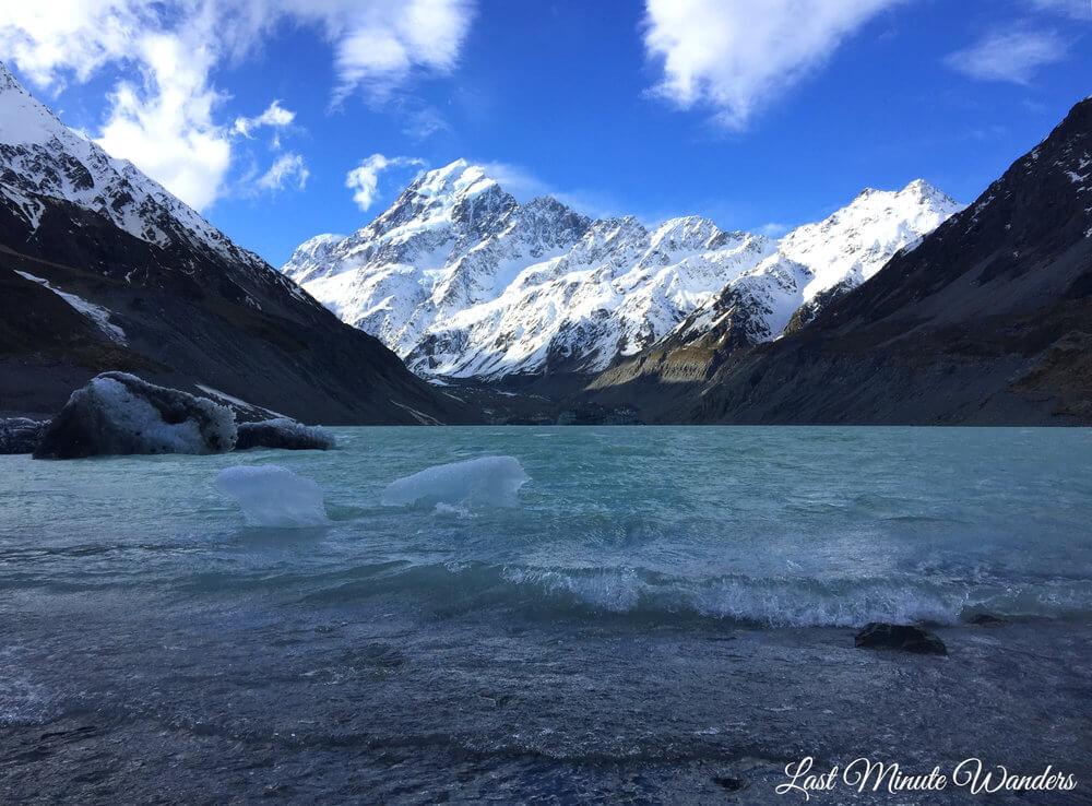 Icebergs in lake below mountain