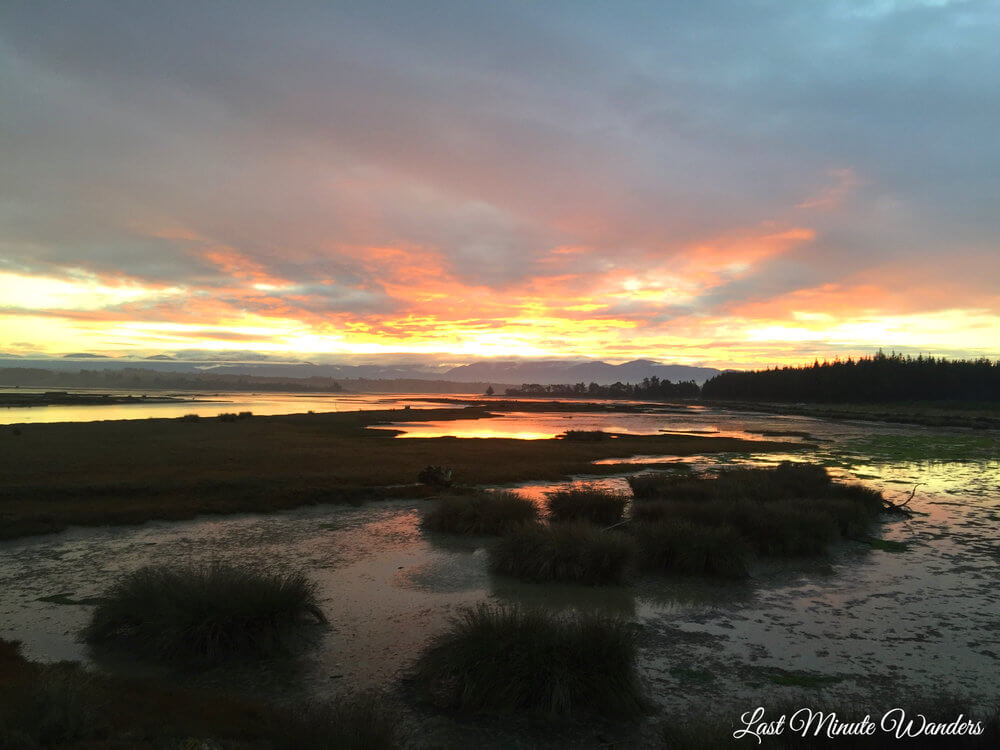 Sunset over wetlands reflecting in water