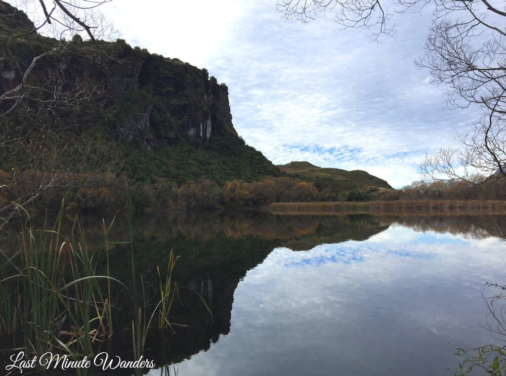 Reflection of cliff in lake