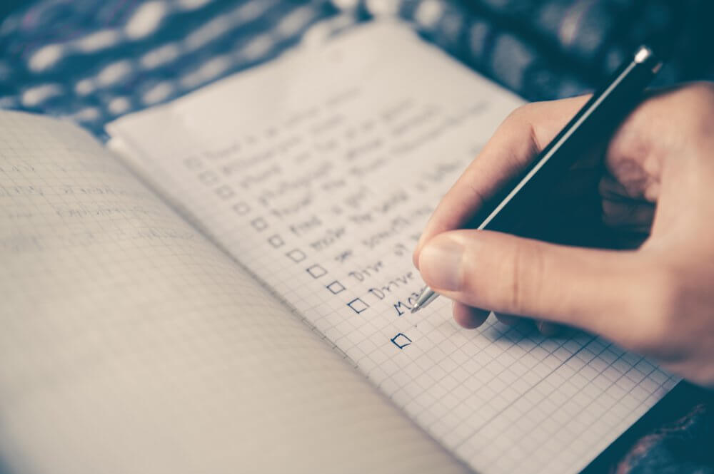 Hand writing checklist in book