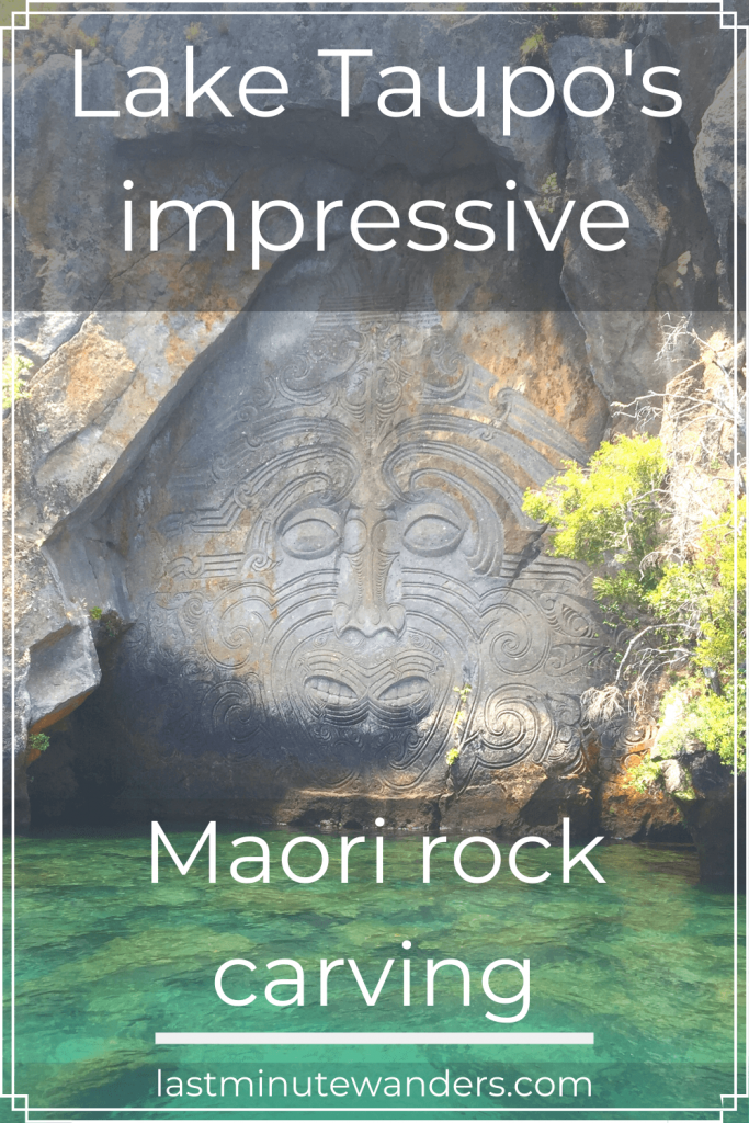 Carving of face in rock with text overlay - Lake Taupo's impressive Maori rock carving