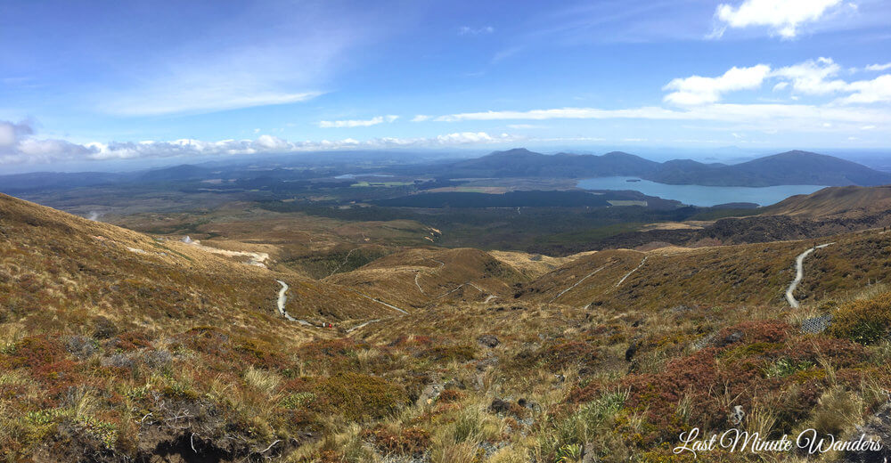 View from mountain of walking track and lake in distance