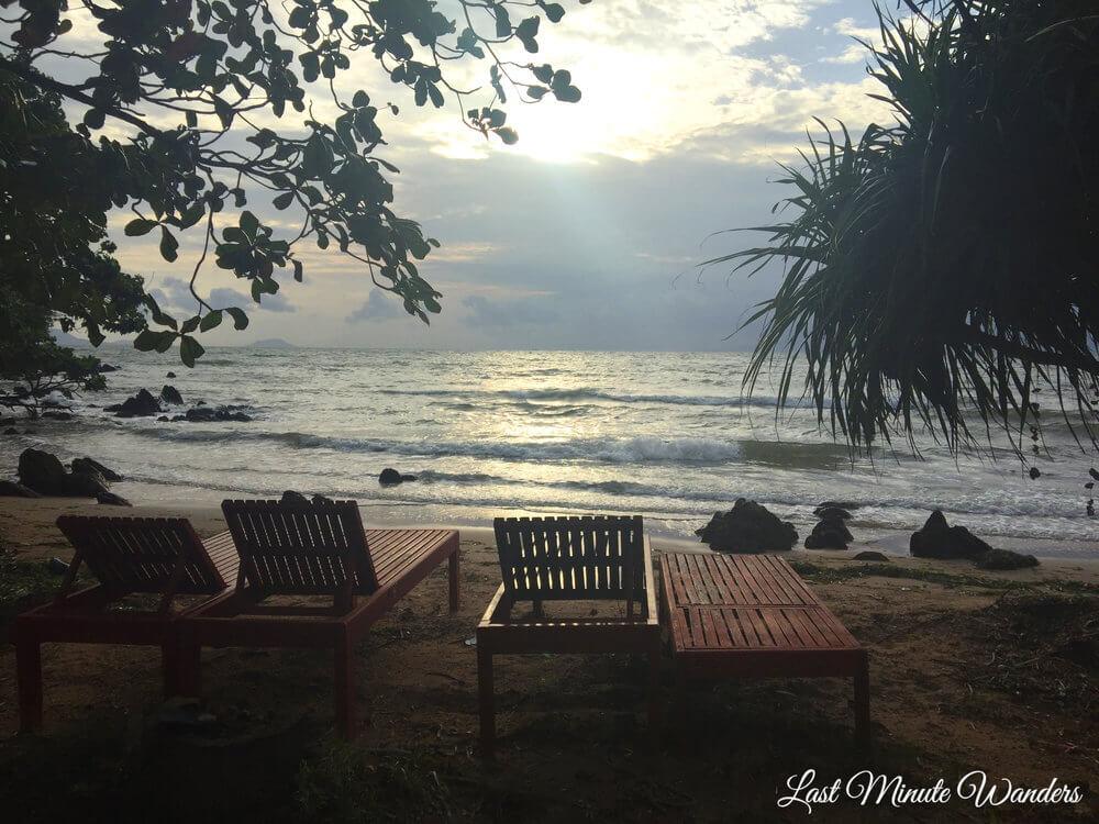 Wooden deckchairs on beach