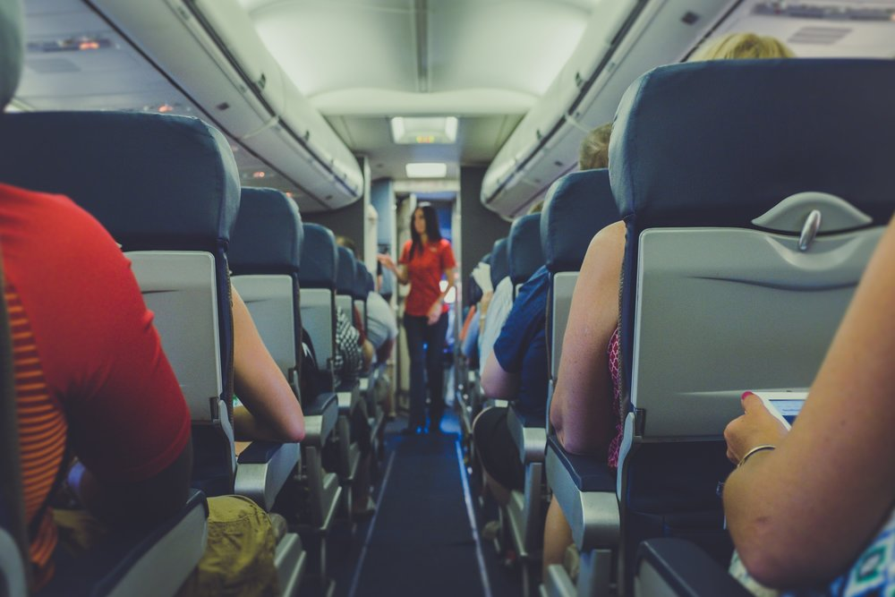 Woman in plane aisle