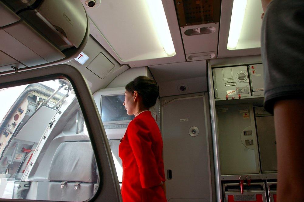 Cabin crew looking to open airplane door