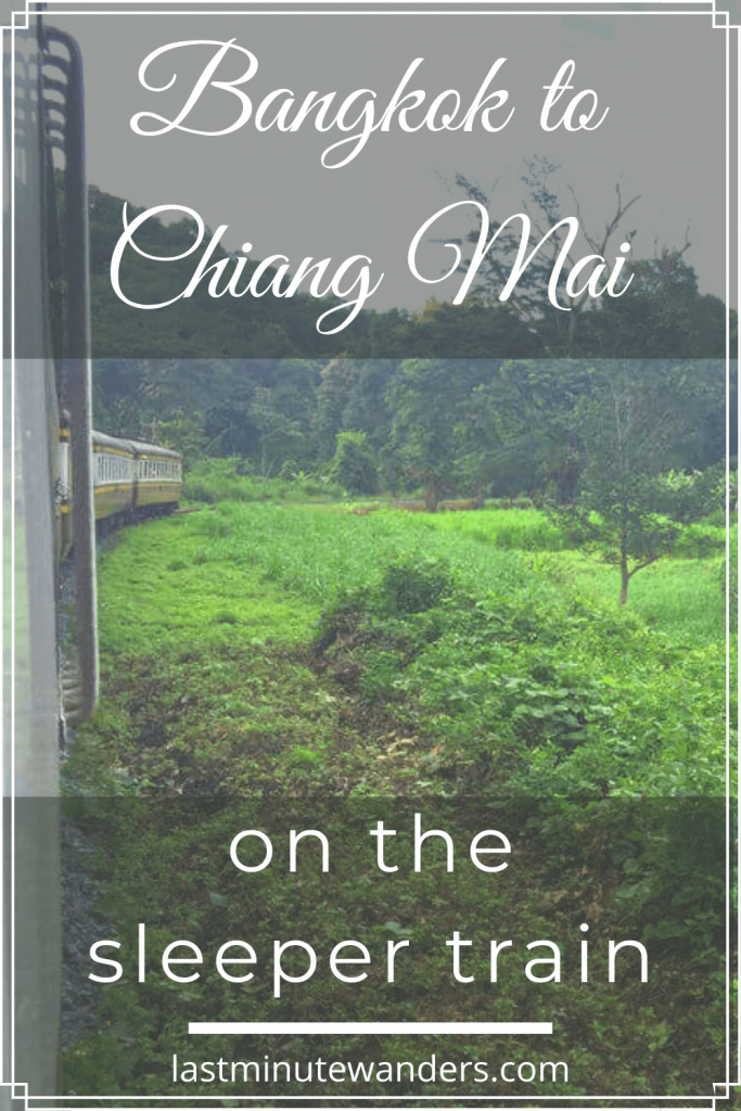 View of train and greenery with text overlay - Bangkok to Chiang Mai on the sleeper train