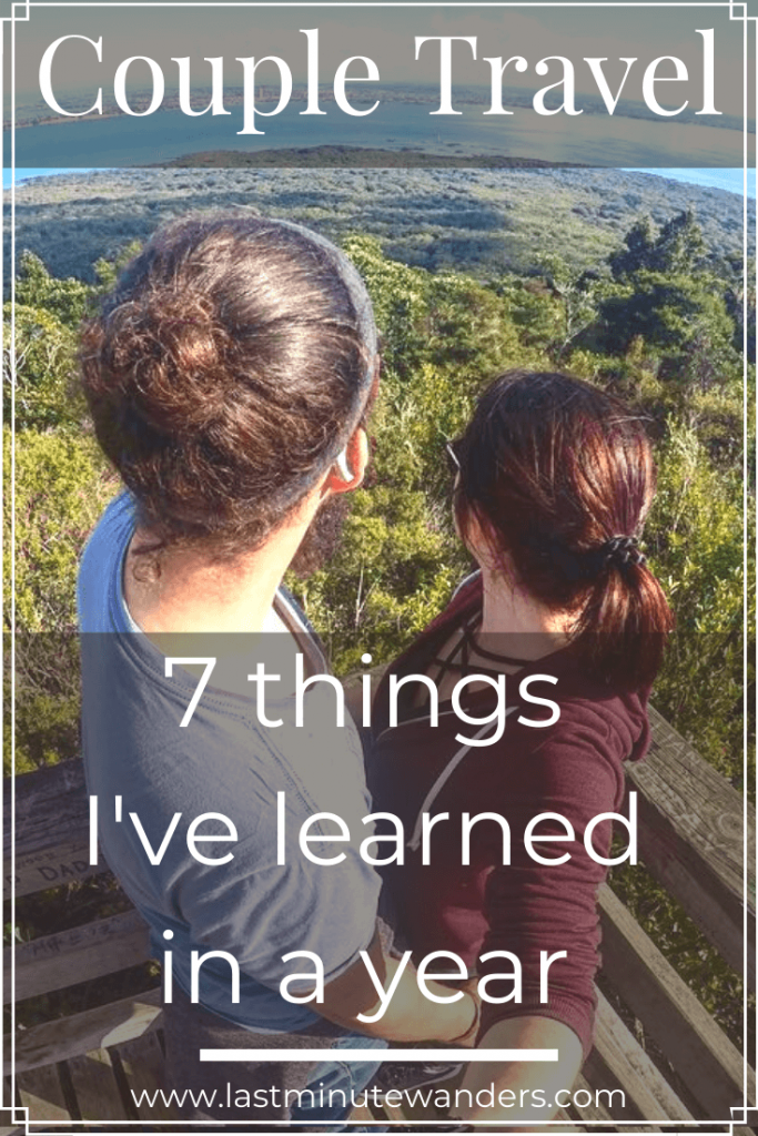 Couple looking away over trees with text overlay - Couple Travel: 7 things I've learned in a year