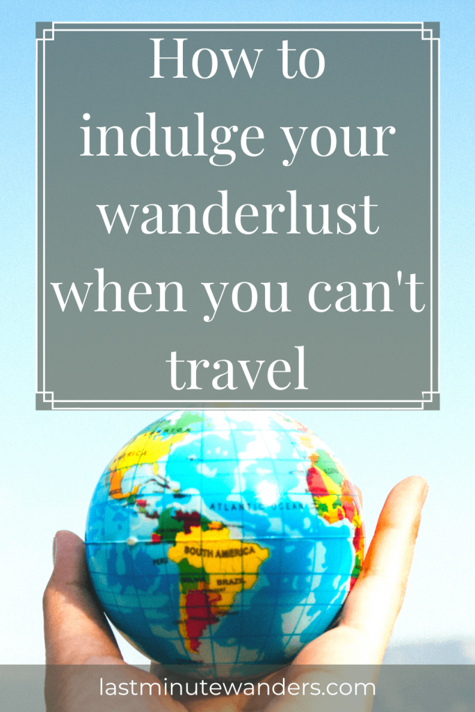 Hand holding globe with text overlay - How to indulge your wanderlust when you can't travel