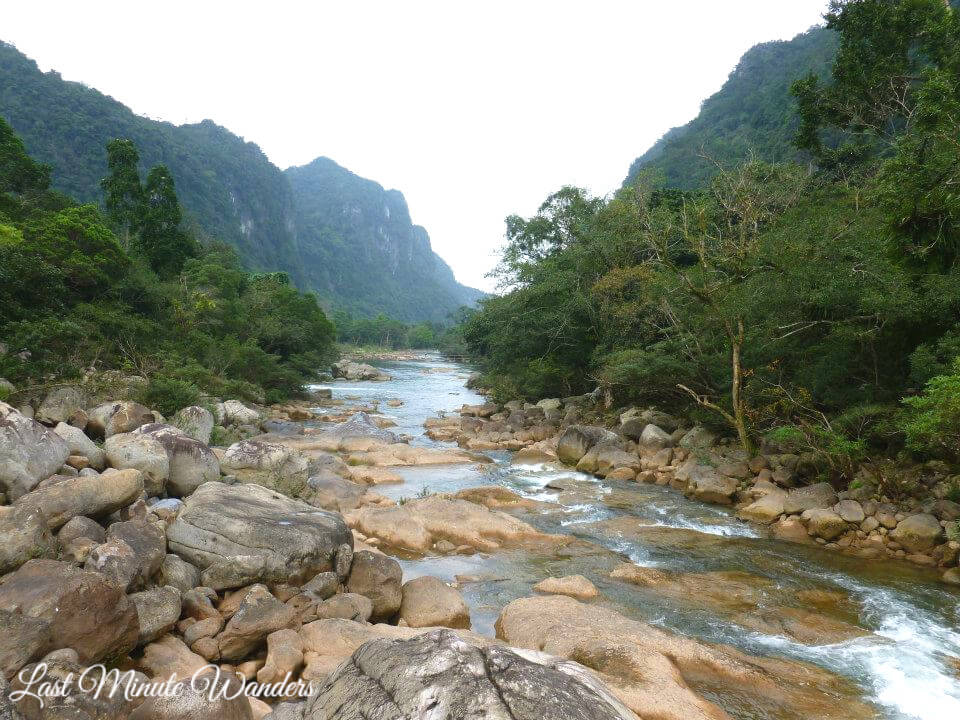 View downriver of trees and mountains in Phong Nha National Park, Vietnam
