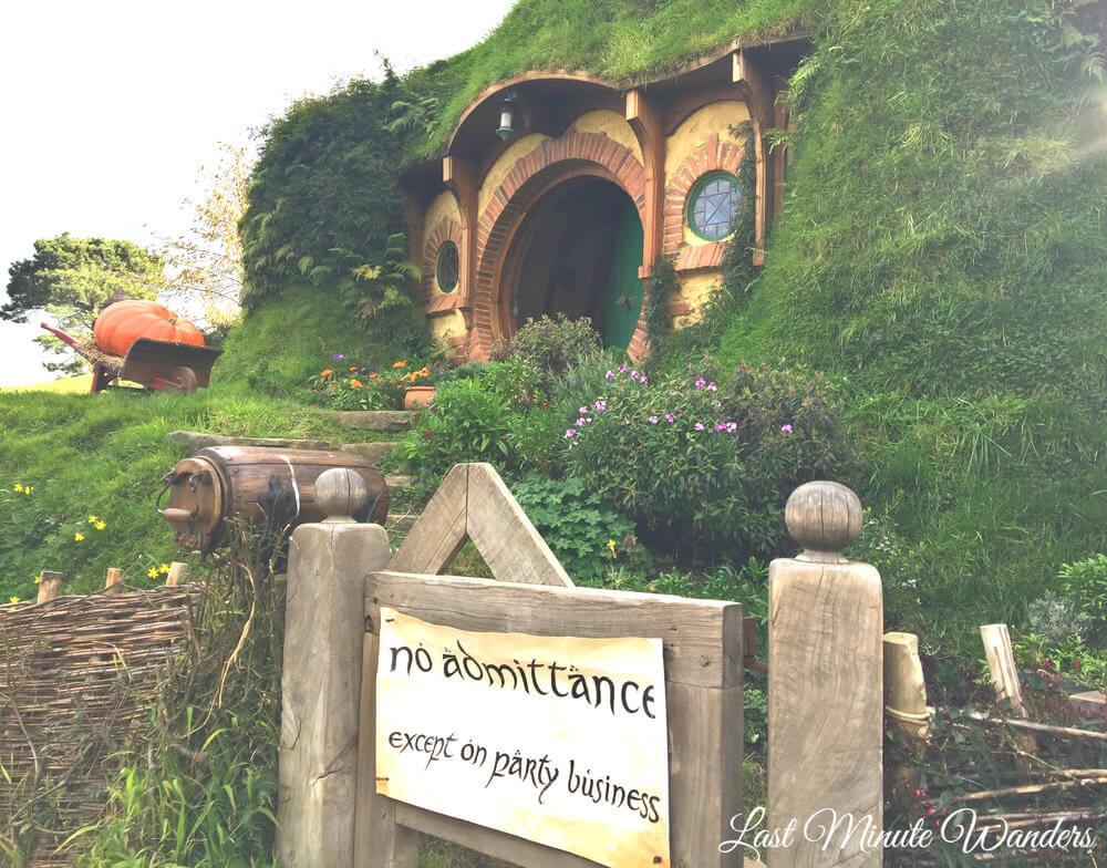 Circular hobbit hole door with party sign