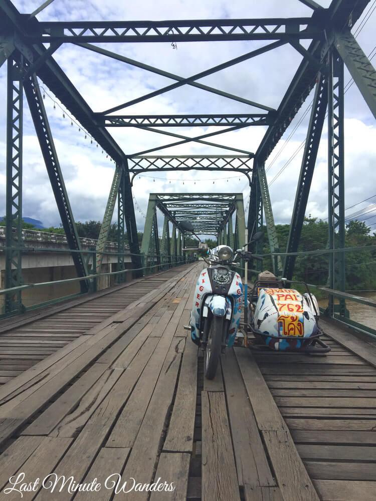 Motorbike and sidecar on wood and steel bridge