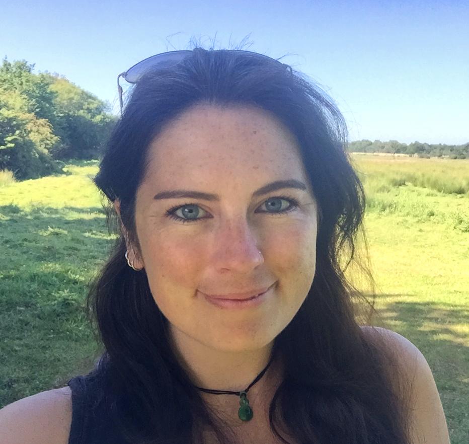 Woman smiling at camera outside