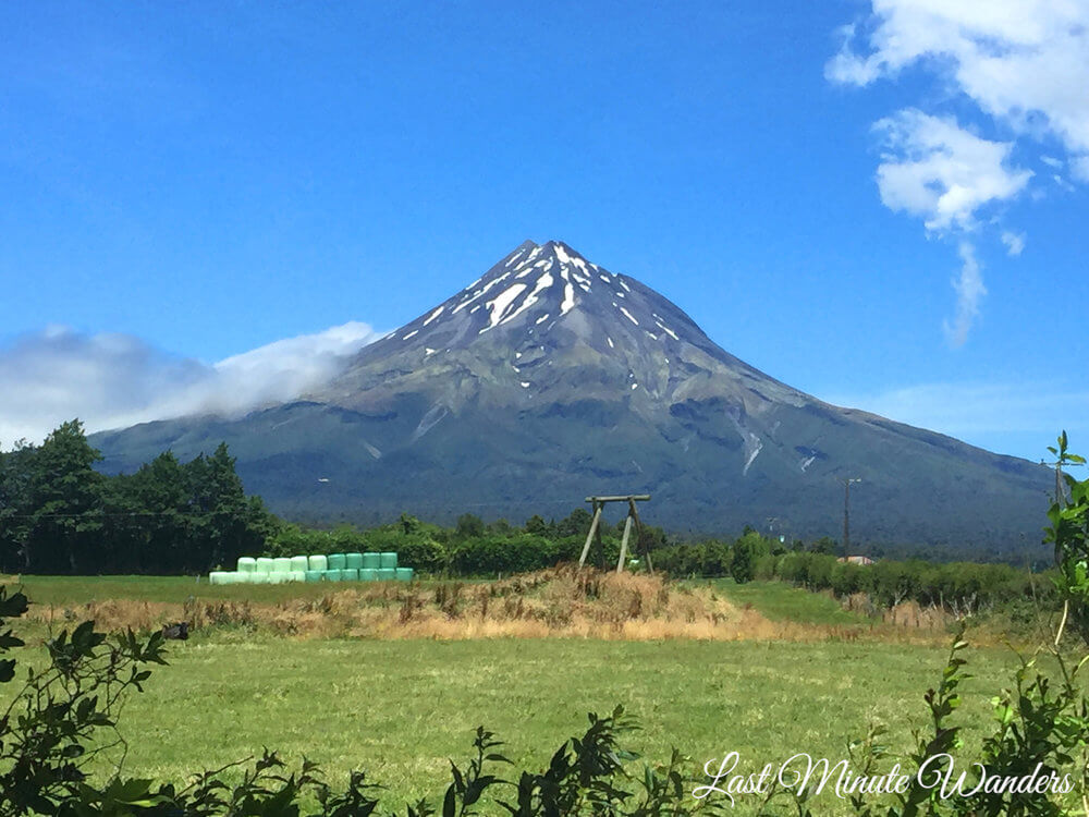 View of tall volcano across fields