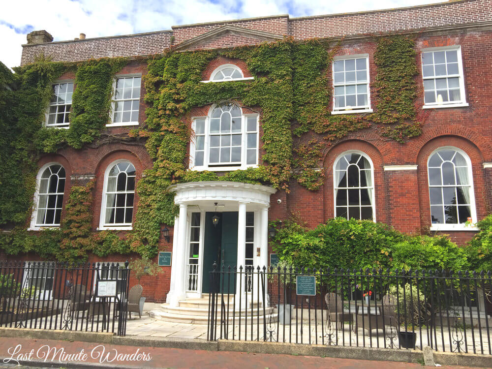 Mansion hotel with ivy growing over red brick