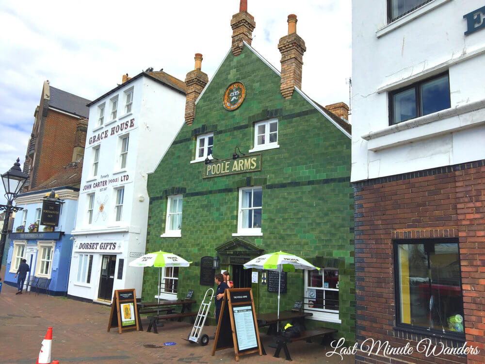 Pub front covered in green tiles