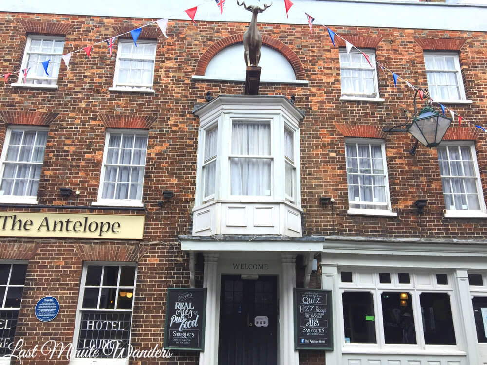 Front of The Antelope pub with antelope statue above doorway