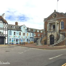 Large building with double staircase and pub
