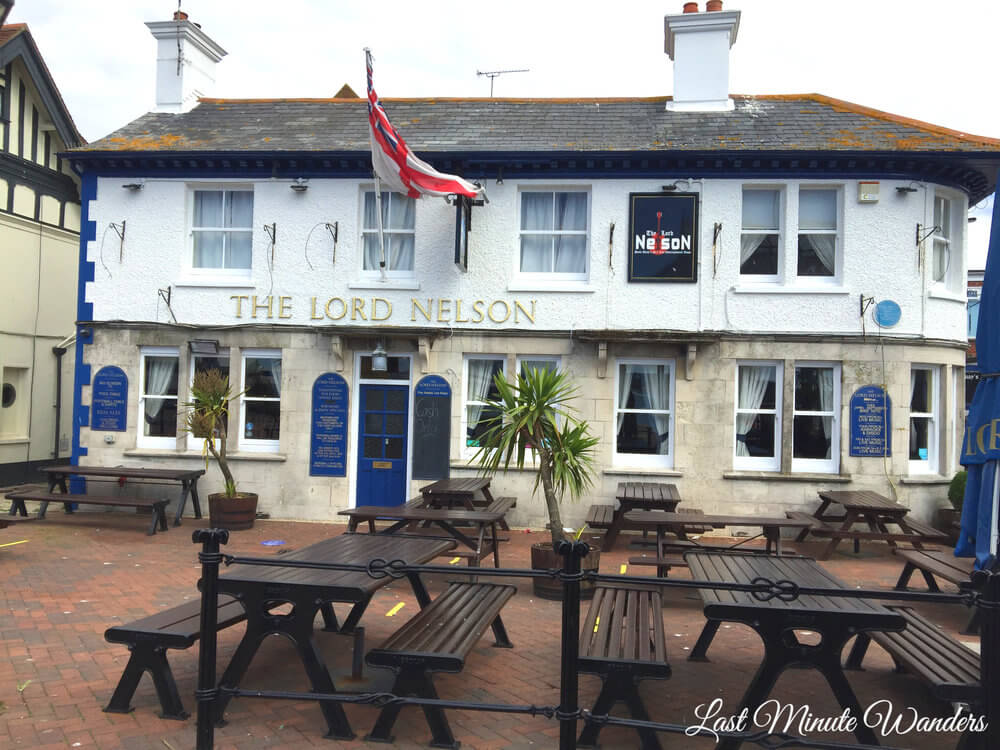 White and grey pub with flag