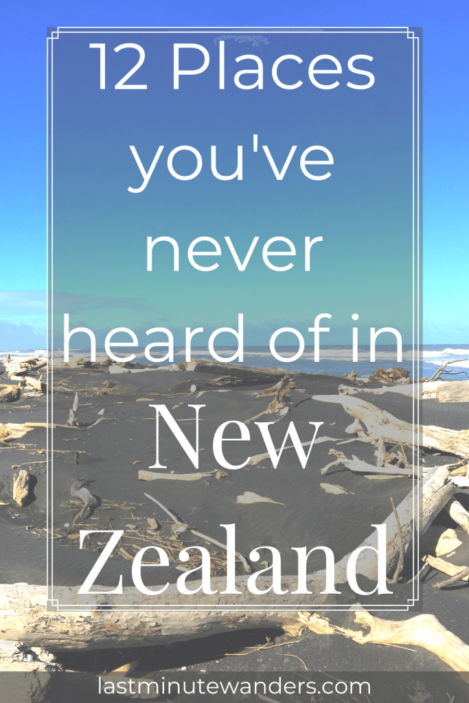 Black sand beach littered with driftwood with text overlay - 12 places you've never heard of in New Zealand