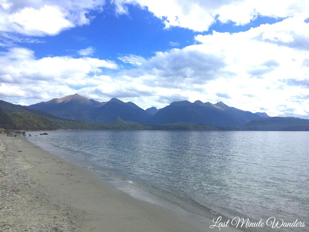 View along lake edge to mountains beyond