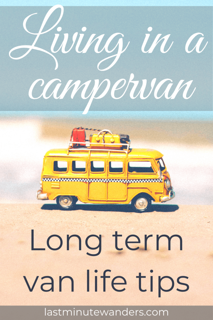 Yellow toy campervan with luggage on roof on sandy coloured ground with text overlay - Living in a campervan: long term van life tips