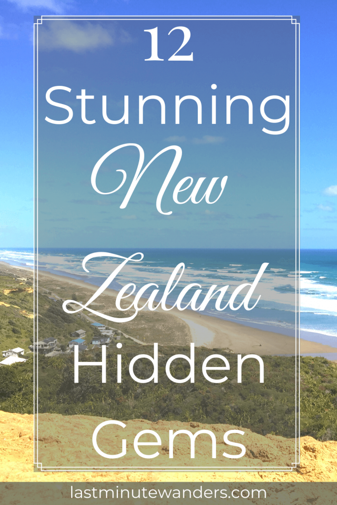 View of yellow sand beach from hilltop with small village and text overlay - 12 stunning New Zealand hidden gems