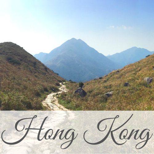 Path leading away towards mountain in distance with text overlay - Hong Kong