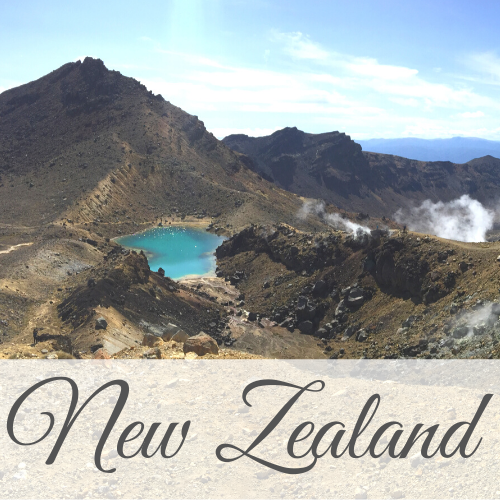 Mountains with blue lake and steam coming from rocks with text overlay - New Zealand