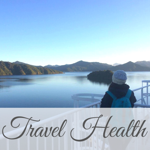 Woman wearing backpack looking from boat deck over water and mountains with text overlay - Travel Health