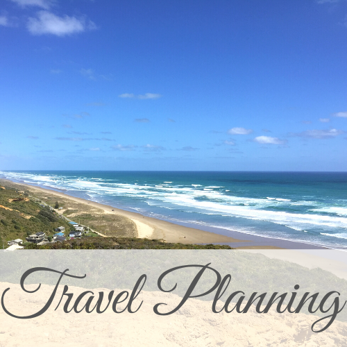 View from hilltop of beach with text overlay - Travel Planning
